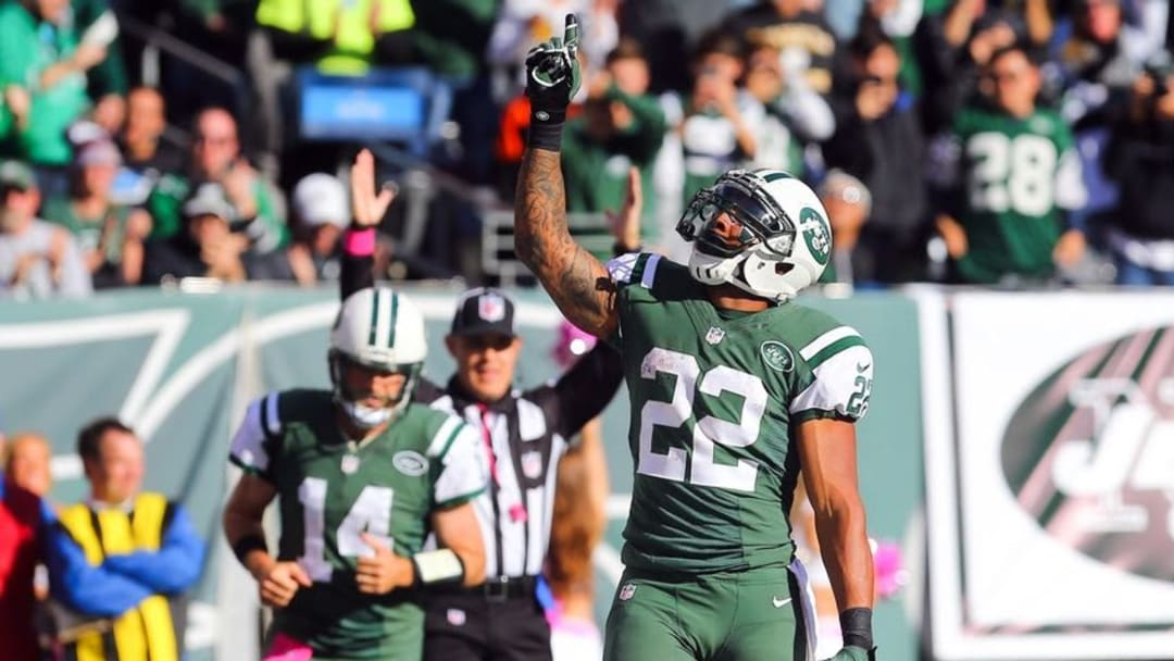 Oct 23, 2016; East Rutherford, NJ, USA; New York Jets running back Matt Forte (22) celebrates his touchdown run during the second half at MetLife Stadium. The Jets defeated the Ravens 24-16. Mandatory Credit: Ed Mulholland-USA TODAY Sports