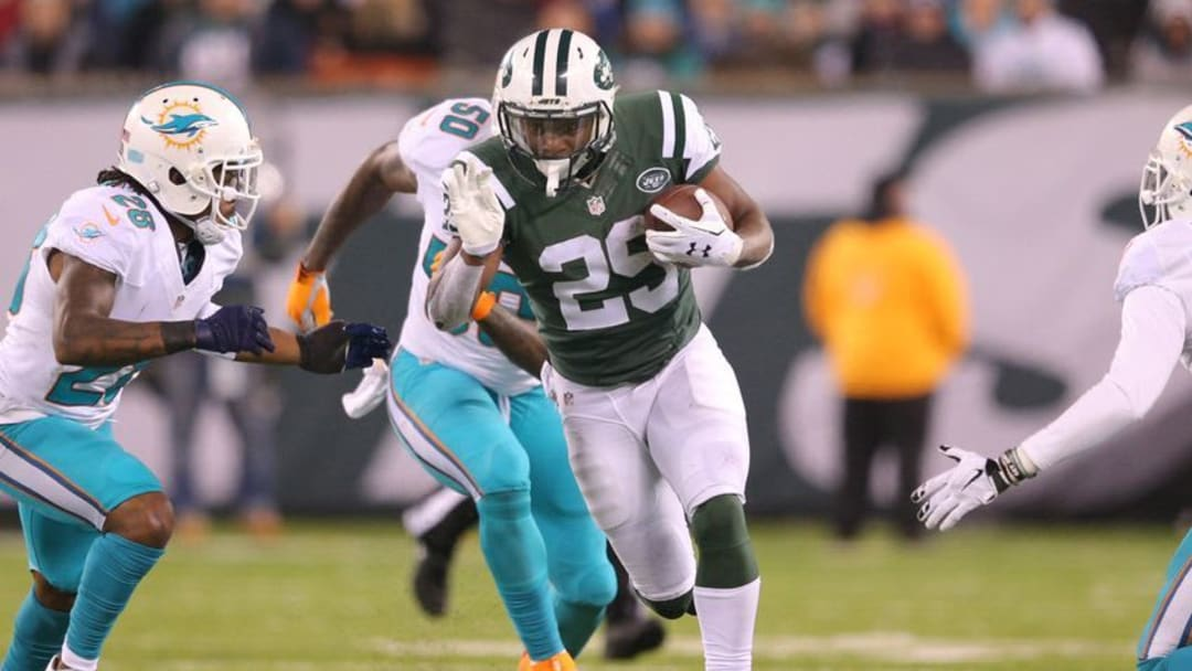 Dec 17, 2016; East Rutherford, NJ, USA; New York Jets running back Bilal Powell (29) runs the ball against Miami Dolphins corner back Bobby McCain (28) during the second quarter at MetLife Stadium. Mandatory Credit: Brad Penner-USA TODAY Sports