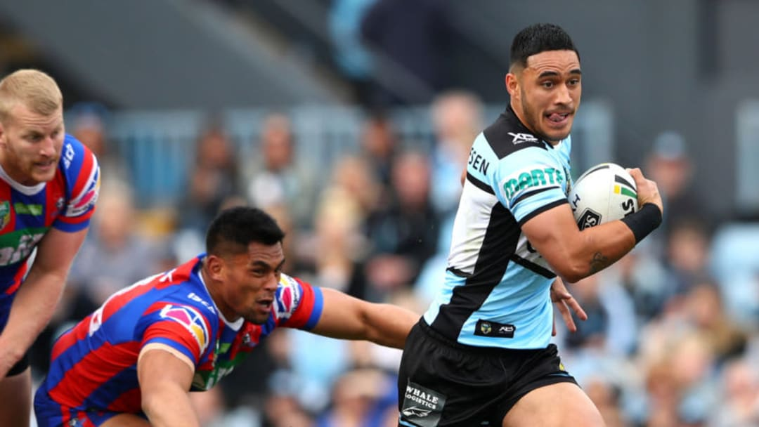 SYDNEY, AUSTRALIA - AUGUST 26: Valentine Holmes of the Sharks makes a break during the round 24 NRL match between the Cronulla Sharks and the Newcastle Knights at Southern Cross Group Stadium on August 26, 2018 in Sydney, Australia. (Photo by Cameron Spencer/Getty Images)