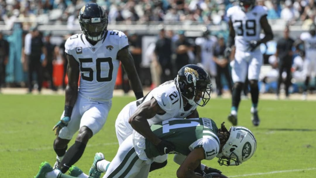 JACKSONVILLE, FL - SEPTEMBER 30: A.J. Bouye #21 of the Jacksonville Jaguars tackles Robby Anderson #11 of the New York Jets during the first half at TIAA Bank Field on September 30, 2018 in Jacksonville, Florida. (Photo by Scott Halleran/Getty Images)