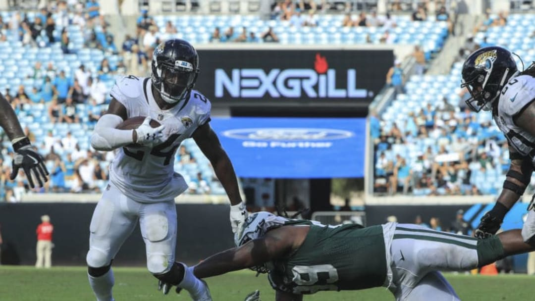 JACKSONVILLE, FL - SEPTEMBER 30: T.J. Yeldon #24 of the Jacksonville Jaguars runs with the ball during the second half against the New York Jets at TIAA Bank Field on September 30, 2018 in Jacksonville, Florida. (Photo by Sam Greenwood/Getty Images)