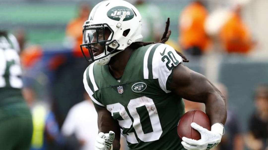 EAST RUTHERFORD, NEW JERSEY - OCTOBER 07: Isaiah Crowell #20 of the New York Jets runs the ball against the Denver Broncos during the first half in the game at MetLife Stadium on October 07, 2018 in East Rutherford, New Jersey. (Photo by Mike Stobe/Getty Images)