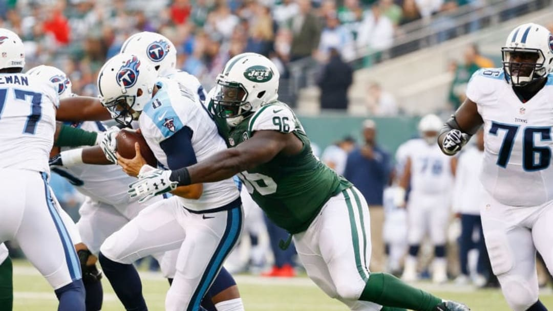 EAST RUTHERFORD, NJ - DECEMBER 13: Muhammad Wilkerson #96 of the New York Jets sacks Marcus Mariota #8 of the Tennessee Titans during their game at MetLife Stadium on December 13, 2015 in East Rutherford, New Jersey. (Photo by Al Bello/Getty Images)