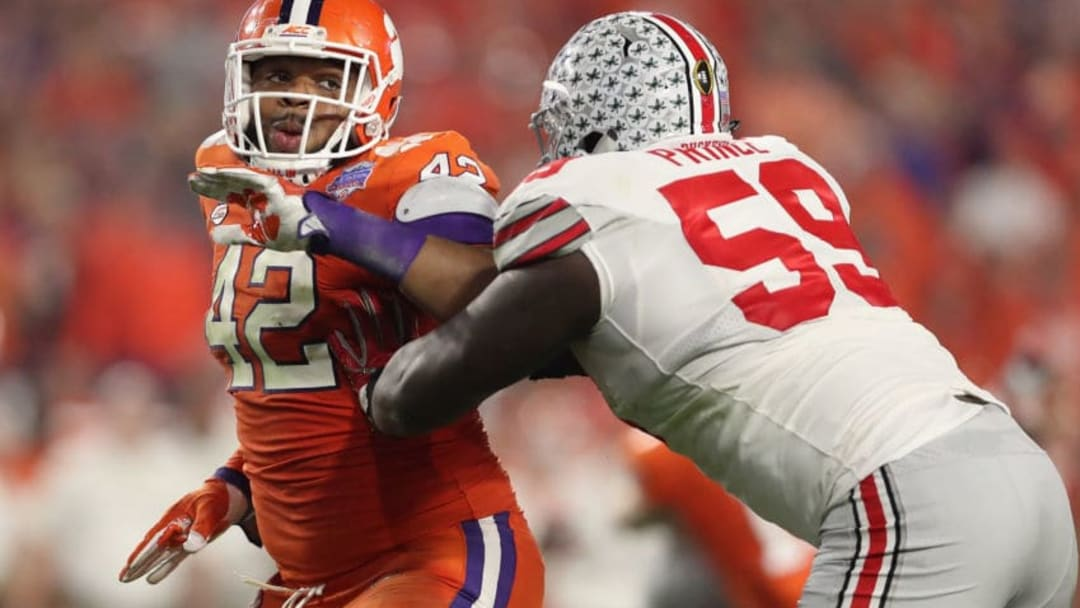 GLENDALE, AZ - DECEMBER 31: Defensive lineman Christian Wilkins #42 (L) of the Clemson Tigers in action against offensive lineman Isaiah Prince #59 of the Ohio State Buckeyes during the Playstation Fiesta Bowl at University of Phoenix Stadium on December 31, 2016 in Glendale, Arizona. The Tigers defeated the Buckeyes 31-0. (Photo by Christian Petersen/Getty Images)