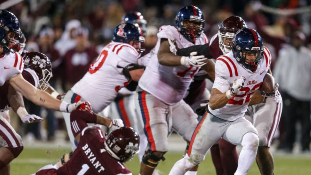 STARKVILLE, MS - NOVEMBER 23: Jordan Wilkins #22 of the Mississippi Rebels breaks through the Mississippi State Bulldogs line and carries in for a touchdown during the second half of an NCAA football game at Davis Wade Stadium on November 23, 2017 in Starkville, Mississippi. (Photo by Butch Dill/Getty Images)