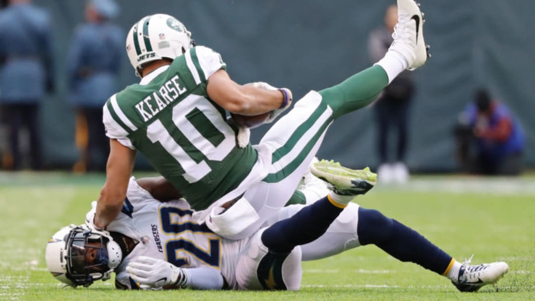 EAST RUTHERFORD, NJ - DECEMBER 24: Jermaine Kearse #10 of the New York Jets is tackled by Desmond King #20 of the Los Angeles Chargers during the first half of an NFL game at MetLife Stadium on December 24, 2017 in East Rutherford, New Jersey. (Photo by Abbie Parr/Getty Images)