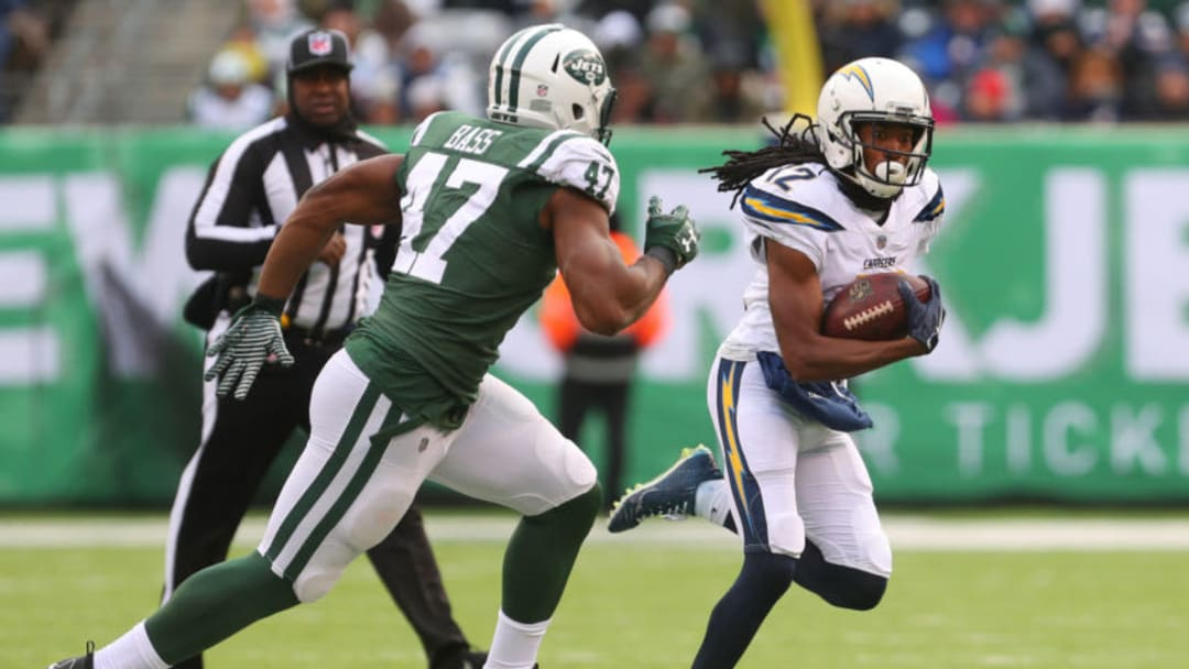 EAST RUTHERFORD, NJ - DECEMBER 24: Travis Benjamin #12 of the Los Angeles Chargers is pursued by David Bass #47 of the New York Jets during the first half of an NFL game at MetLife Stadium on December 24, 2017 in East Rutherford, New Jersey. (Photo by Ed Mulholland/Getty Images)