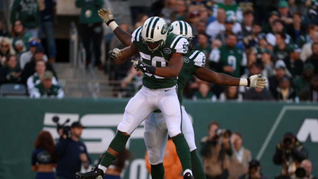 EAST RUTHERFORD, NJ - NOVEMBER 13: Lorenzo Mauldin #55 of the New York Jets celebrates sacking quarterback Case Keenum #17 of the Los Angeles Rams with teammate Darron Lee #50 in the second quarter at MetLife Stadium on November 13, 2016 in East Rutherford, New Jersey. (Photo by Michael Reaves/Getty Images)