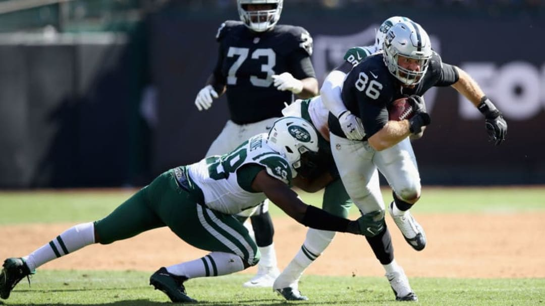 OAKLAND, CA - SEPTEMBER 17: Lee Smith #86 of the Oakland Raiders tries to break free from Jordan Jenkins #48 of the New York Jets at Oakland-Alameda County Coliseum on September 17, 2017 in Oakland, California. (Photo by Ezra Shaw/Getty Images)