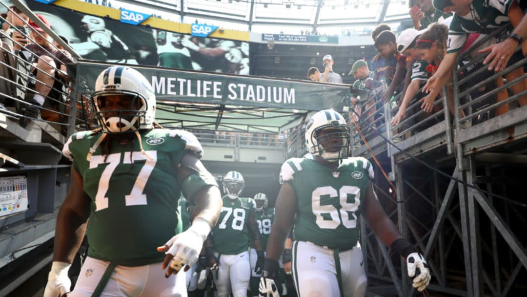 EAST RUTHERFORD, NJ - SEPTEMBER 24: James Carpenter #77 and Kelvin Beachum #68 of the New York Jets walk out of the tunnel prior to an NFL game against the Miami Dolphins at MetLife Stadium on September 24, 2017 in East Rutherford, New Jersey. (Photo by Al Bello/Getty Images)