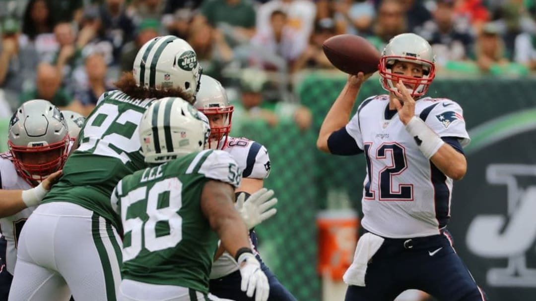 EAST RUTHERFORD, NJ - OCTOBER 15: Quarterback Tom Brady #12 of the New England Patriots looks to pass against the New York Jets during the second quarter of their game at MetLife Stadium on October 15, 2017 in East Rutherford, New Jersey. The New England Patriots won 24-17. (Photo by Abbie Parr/Getty Images)