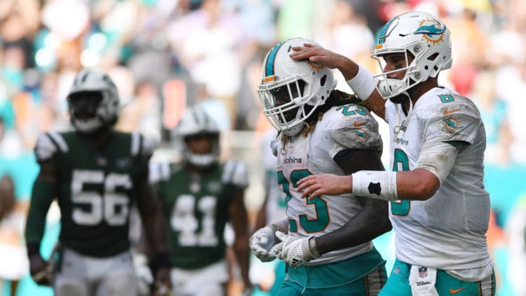 MIAMI GARDENS, FL - OCTOBER 22: Matt Moore #8 of the Miami Dolphins and Jay Ajayi #23 of the Miami Dolphins during the game against the New York Jets at Hard Rock Stadium on October 22, 2017 in Miami Gardens, Florida. (Photo by Rob Foldy/Getty Images)