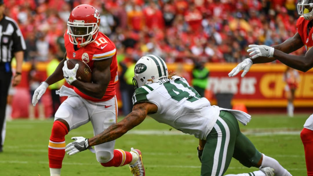 KANSAS CITY, MO - SEPTEMBER 25: Wide receiver Tyreek Hill #10 of the Kansas City Chiefs attempts to run through the tackle of cornerback Buster Skrine #41 of the New York Jets at Arrowhead Stadium during the third quarter of the game on September 25, 2016 in Kansas City, Missouri. (Photo by Peter Aiken/Getty Images)
