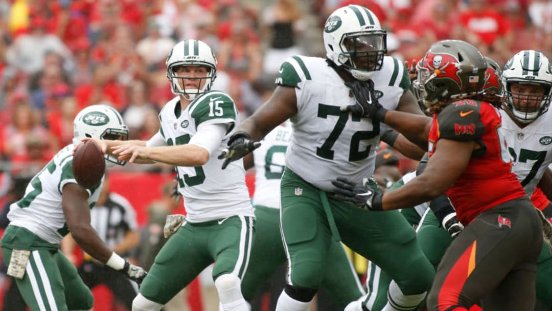 TAMPA, FL - NOVEMBER 12: Quarterback Josh McCown #15 of the New York Jets drops back for a pass while getting protection by offensive tackle Brandon Shell #72 from pressure from middle defensive end Darryl Tapp #56 of the Tampa Bay Buccaneers during the first quarter of an NFL football game on November 12, 2017 at Raymond James Stadium in Tampa, Florida. (Photo by Brian Blanco/Getty Images)