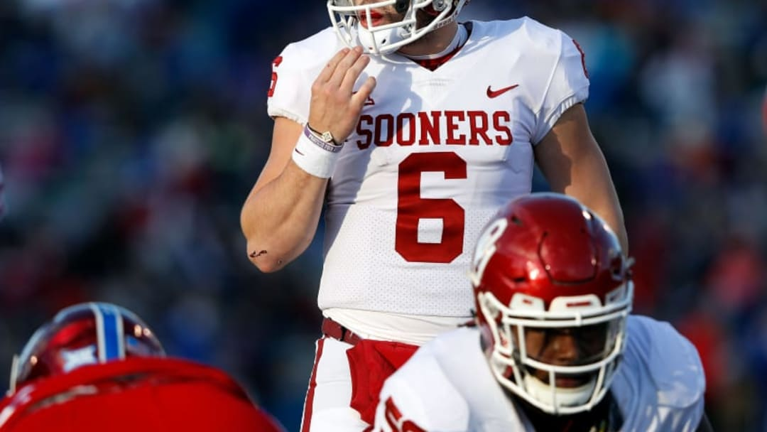 LAWRENCE, KS - NOVEMBER 18: Quarterback Baker Mayfield #6 of the Oklahoma Sooners prepares to take a snap during the game against the Kansas Jayhawks at Memorial Stadium on November 18, 2017 in Lawrence, Kansas. (Photo by Jamie Squire/Getty Images)