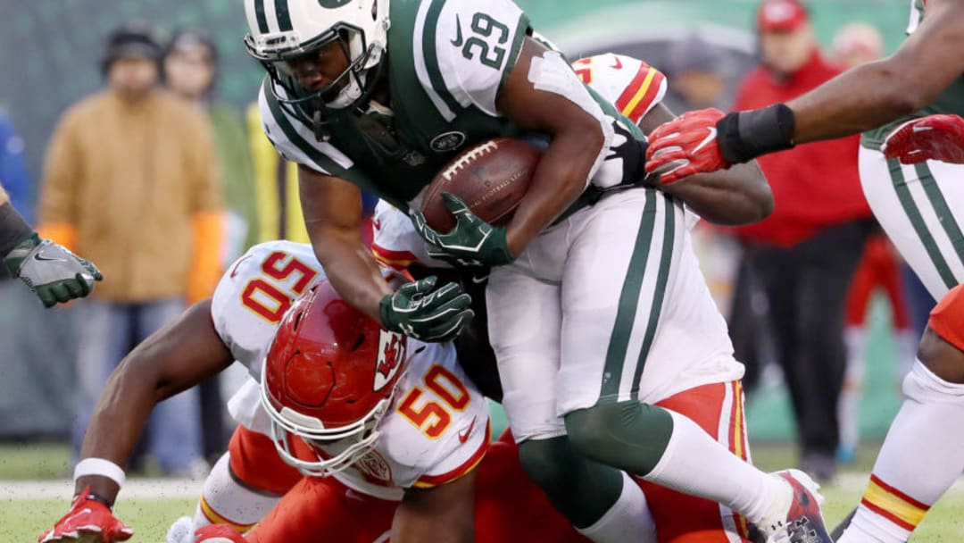 EAST RUTHERFORD, NEW JERSEY - DECEMBER 03: Bilal Powell #29 of the New York Jets carries the ball as Justin Houston #50 of the Kansas City Chiefs defends on December 03, 2017 at MetLife Stadium in East Rutherford, New Jersey.The New York Jets defeated the Kansas City Chiefs 38-31. (Photo by Elsa/Getty Images)