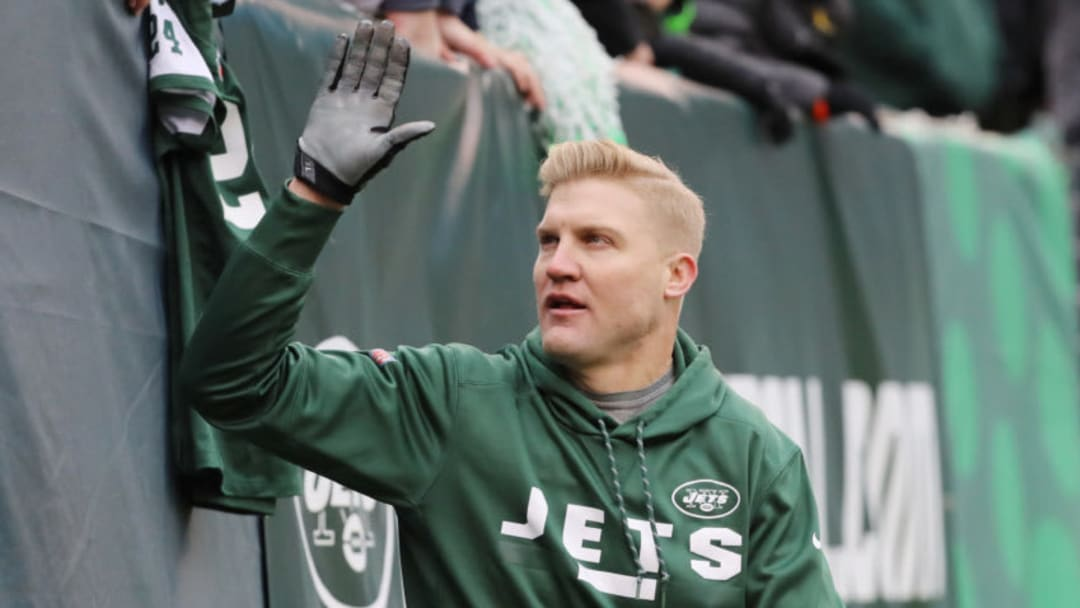 EAST RUTHERFORD, NJ - DECEMBER 24: Josh McCown #15 of the New York Jets high fives the fans prior to an NFL game against the Los Angeles Chargers at MetLife Stadium on December 24, 2017 in East Rutherford, New Jersey. (Photo by Abbie Parr/Getty Images)