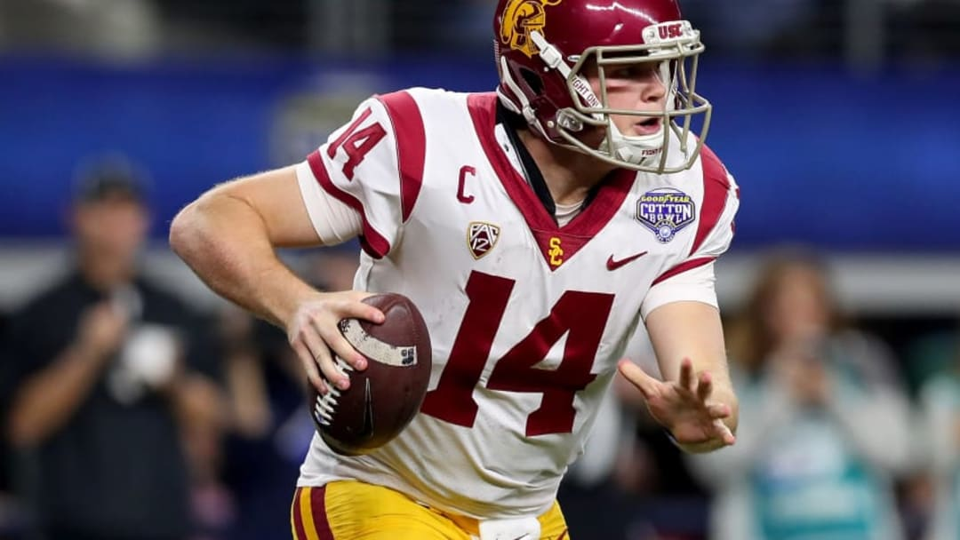 ARLINGTON, TX - DECEMBER 29: Sam Darnold #14 of the USC Trojans looks for an open receiver against the Ohio State Buckeyes during the Goodyear Cotton Bowl Classic at AT&T Stadium on December 29, 2017 in Arlington, Texas. (Photo by Tom Pennington/Getty Images)
