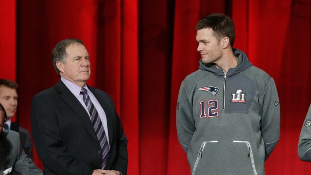 HOUSTON, TX - JANUARY 30: Head coach Bill Belichick of the New England Patriots and Tom Brady #12 stand onstage during Super Bowl 51 Opening Night at Minute Maid Park on January 30, 2017 in Houston, Texas. (Photo by Bob Levey/Getty Images)