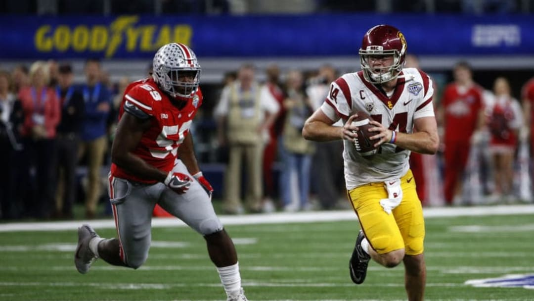 ARLINGTON, TX - DECEMBER 29: Sam Darnold #14 of the USC Trojans runs from Tyquan Lewis #59 of the Ohio State Buckeyes in the second half of the 82nd Goodyear Cotton Bowl Classic between USC and Ohio State at AT&T Stadium on December 29, 2017 in Arlington, Texas. Ohio State won 24-7. (Photo by Ron Jenkins/Getty Images)