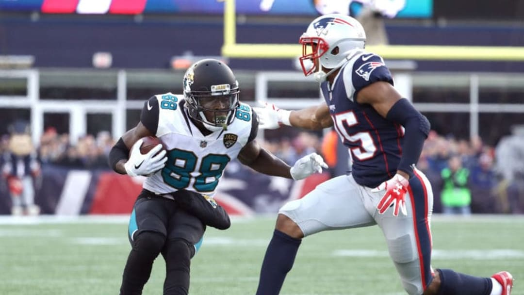 FOXBOROUGH, MA - JANUARY 21: Allen Hurns #88 of the Jacksonville Jaguars carries the ball after a catch as he is defended by Eric Rowe #25 of the New England Patriots in the second half of the AFC Championship Game at Gillette Stadium on January 21, 2018 in Foxborough, Massachusetts. (Photo by Maddie Meyer/Getty Images)