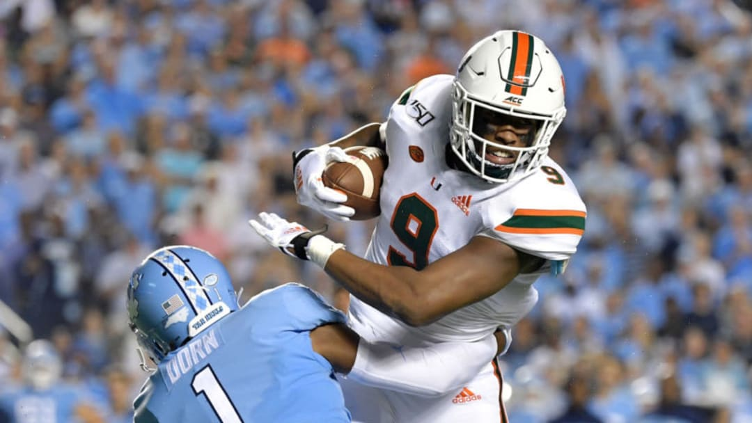 CHAPEL HILL, NORTH CAROLINA - SEPTEMBER 07: Myles Dorn #1 of the North Carolina Tar Heels tackles Brevin Jordan #9 of the Miami Hurricanes during the first half of their game at Kenan Stadium on September 07, 2019 in Chapel Hill, North Carolina. (Photo by Grant Halverson/Getty Images)