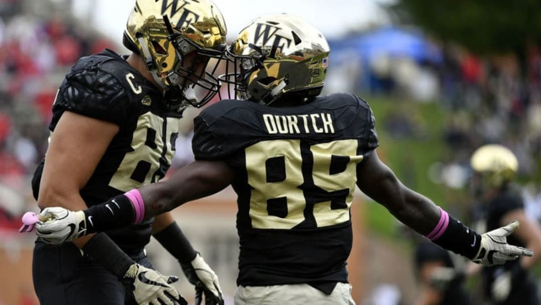WINSTON SALEM, NC - OCTOBER 28: Wide receiver Greg Dortch #89 celebrates with tight end Cam Serigne #85 of the Wake Forest Demon Deacons after scoring a touchdown against the Louisville Cardinals late in the first quarter of the football game at BB&T Field on October 28, 2017 in Winston Salem, North Carolina. (Photo by Mike Comer/Getty Images)