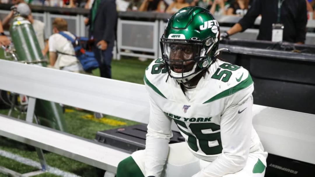ATLANTA, GA - AUGUST 15: Jachai Polite #56 of the New York Jets rests on the bench during the second half of an NFL preseason game against the Atlanta Falcons at Mercedes-Benz Stadium on August 15, 2019 in Atlanta, Georgia. (Photo by Todd Kirkland/Getty Images)
