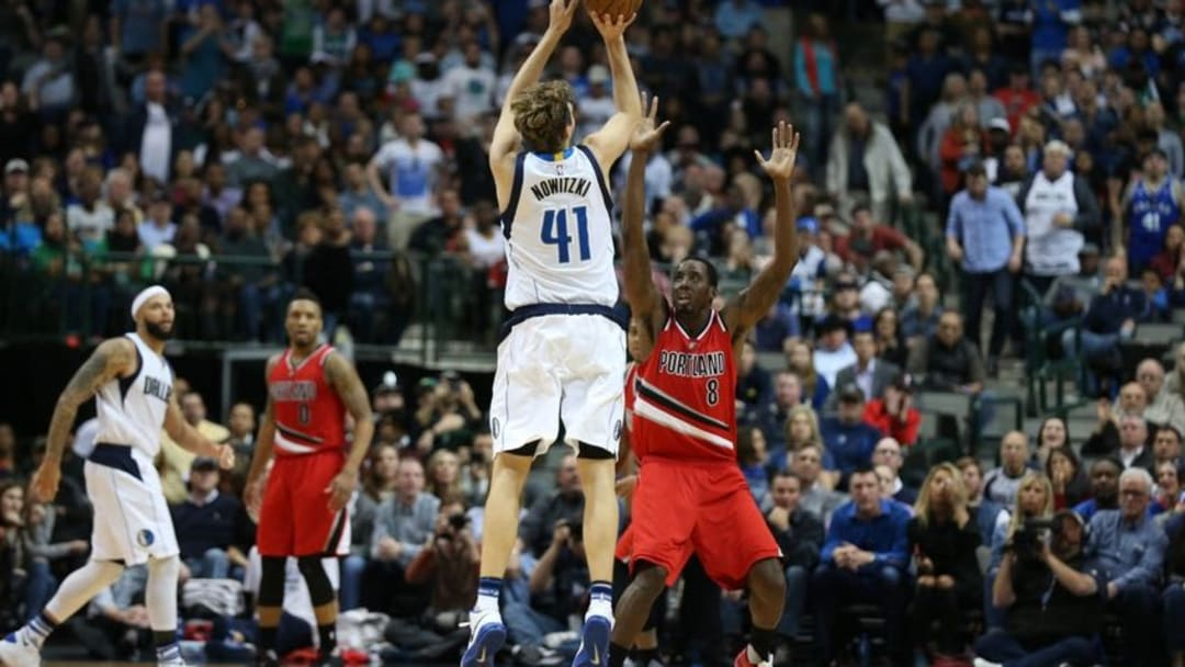 Mar 20, 2016; Dallas, TX, USA; Dallas Mavericks forward Dirk Nowitzki (41) shoots a three point basket in overtime against the Portland Trail Blazers at American Airlines Center. The Mavs beat the Trail Blazers 132-120. Mandatory Credit: Matthew Emmons-USA TODAY Sports