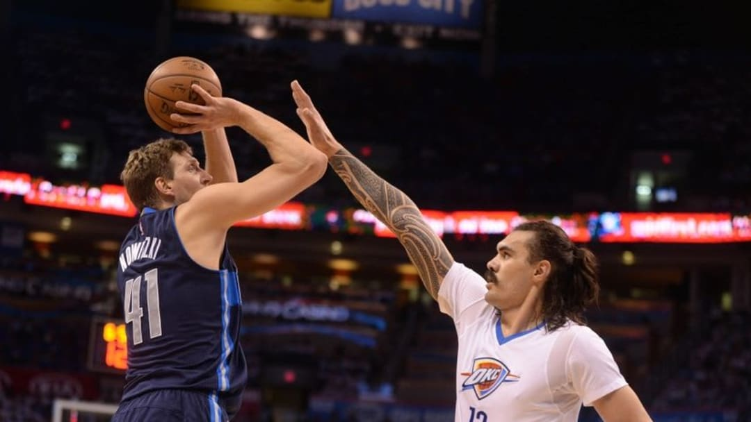 Apr 16, 2016; Oklahoma City, OK, USA; Dallas Mavericks forward Dirk Nowitzki (41) shoots the ball over Oklahoma City Thunder center Steven Adams (12) during the first quarter in game one of the NBA Playoffs series at Chesapeake Energy Arena. Mandatory Credit: Mark D. Smith-USA TODAY Sports
