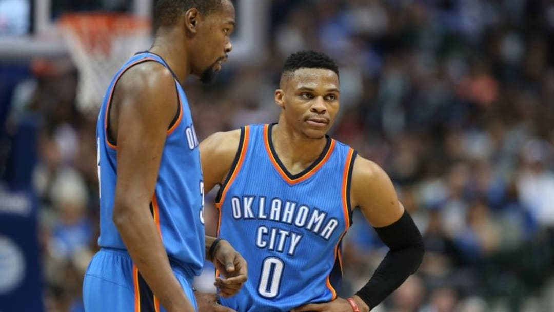 Feb 24, 2016; Dallas, TX, USA; Oklahoma City Thunder forward Kevin Durant (35) talks with guard Russell Westbrook (0) during the game against the Dallas Mavericks at American Airlines Center. The Thunder beat the Mavs 116-103. Mandatory Credit: Matthew Emmons-USA TODAY Sports