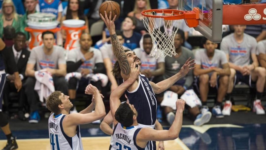 Apr 21, 2016; Dallas, TX, USA; Oklahoma City Thunder center Steven Adams (12) fights for a rebound against the Dallas Mavericks in game three of the first round of the NBA Playoffs at American Airlines Center. Mandatory Credit: Jerome Miron-USA TODAY Sports