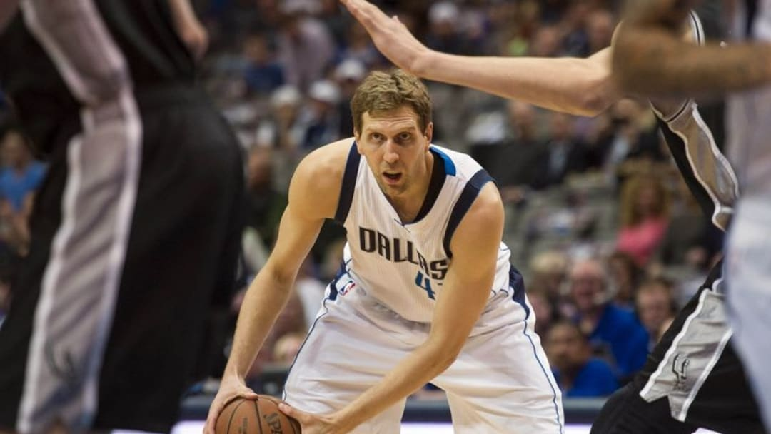 Apr 13, 2016; Dallas, TX, USA; Dallas Mavericks forward Dirk Nowitzki (41) looks to set the play against the San Antonio Spurs during the first quarter at the American Airlines Center. Mandatory Credit: Jerome Miron-USA TODAY Sports