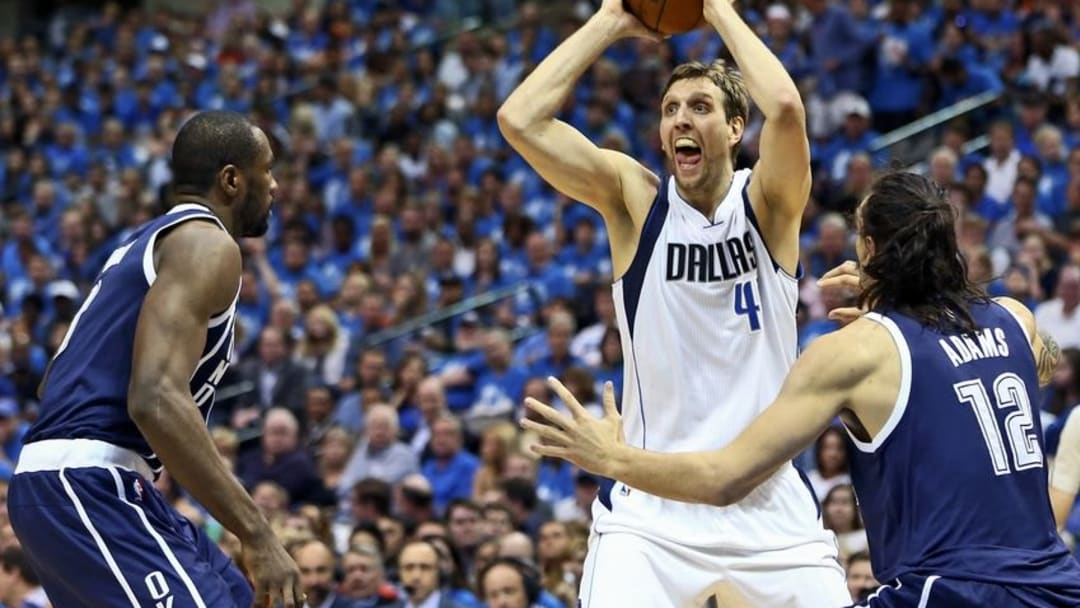 Apr 23, 2016; Dallas, TX, USA; Dallas Mavericks forward Dirk Nowitzki (41) looks to pass as Oklahoma City Thunder center Steven Adams (12) defends during the second quarter in game four of the first round of the NBA Playoffs at American Airlines Center. Mandatory Credit: Kevin Jairaj-USA TODAY Sports