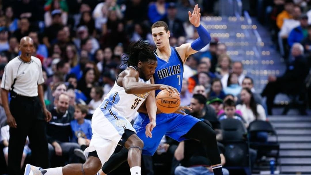 Mar 28, 2016; Denver, CO, USA; Dallas Mavericks forward Dwight Powell (7) defends against Denver Nuggets forward Kenneth Faried (35) in the third quarter at the Pepsi Center. The Mavericks defeated the Nuggets 97-88. Mandatory Credit: Isaiah J. Downing-USA TODAY Sports
