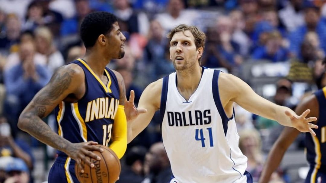 Mar 12, 2016; Dallas, TX, USA; Indiana Pacers forward Paul George (13) looks to pass as Dallas Mavericks forward Dirk Nowitzki (41) defends during the first quarter at American Airlines Center. Mandatory Credit: Kevin Jairaj-USA TODAY Sports