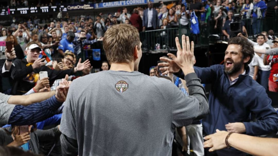DALLAS, TX - MARCH 7: Dirk Nowitzki #41 of the Dallas Mavericks high fives with a fan after the game against the Los Angeles Lakers on March 7, 2017 at the American Airlines Center in Dallas, Texas. NOTE TO USER: User expressly acknowledges and agrees that, by downloading and or using this photograph, User is consenting to the terms and conditions of the Getty Images License Agreement. Mandatory Copyright Notice: Copyright 2017 NBAE (Photo by Glenn James/NBAE via Getty Images)