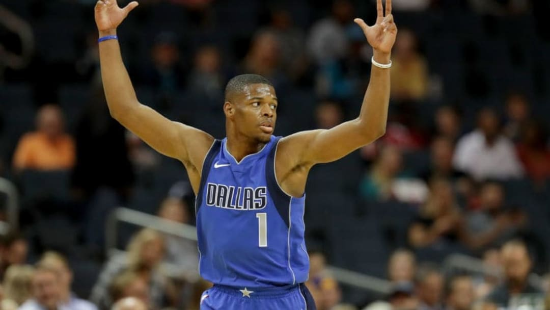 CHARLOTTE, NC - OCTOBER 13: Dennis Smith Jr. #1 of the Dallas Mavericks reacts after a basket against the Charlotte Hornets during their game at Spectrum Center on October 13, 2017 in Charlotte, North Carolina. NOTE TO USER: User expressly acknowledges and agrees that, by downloading and or using this photograph, User is consenting to the terms and conditions of the Getty Images License Agreement. (Photo by Streeter Lecka/Getty Images)