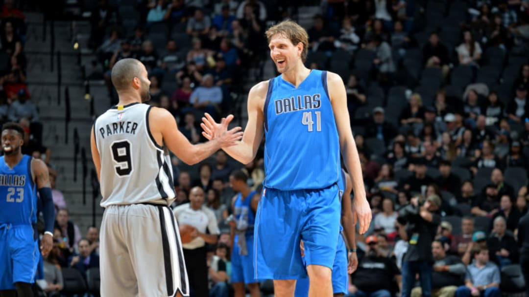 SAN ANTONIO, TX - JANUARY 29: Dirk Nowitzki #41 of the Dallas Mavericks shakes hands with Tony Parker #9 of the San Antonio Spurs during the game on January 29, 2017 at the AT&T Center in San Antonio, Texas. NOTE TO USER: User expressly acknowledges and agrees that, by downloading and or using this photograph, user is consenting to the terms and conditions of the Getty Images License Agreement. Mandatory Copyright Notice: Copyright 2017 NBAE (Photos by Mark Sobhani/NBAE via Getty Images)