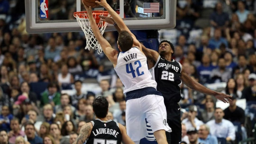 DALLAS, TX - NOVEMBER 14: Maximilian Kleber #42 of the Dallas Mavericks makes the slam dunk against Rudy Gay #22 of the San Antonio Spurs in the first half at American Airlines Center on November 14, 2017 in Dallas, Texas. NOTE TO USER: User expressly acknowledges and agrees that, by downloading and or using this photograph, User is consenting to the terms and conditions of the Getty Images License Agreement. (Photo by Ronald Martinez/Getty Images)