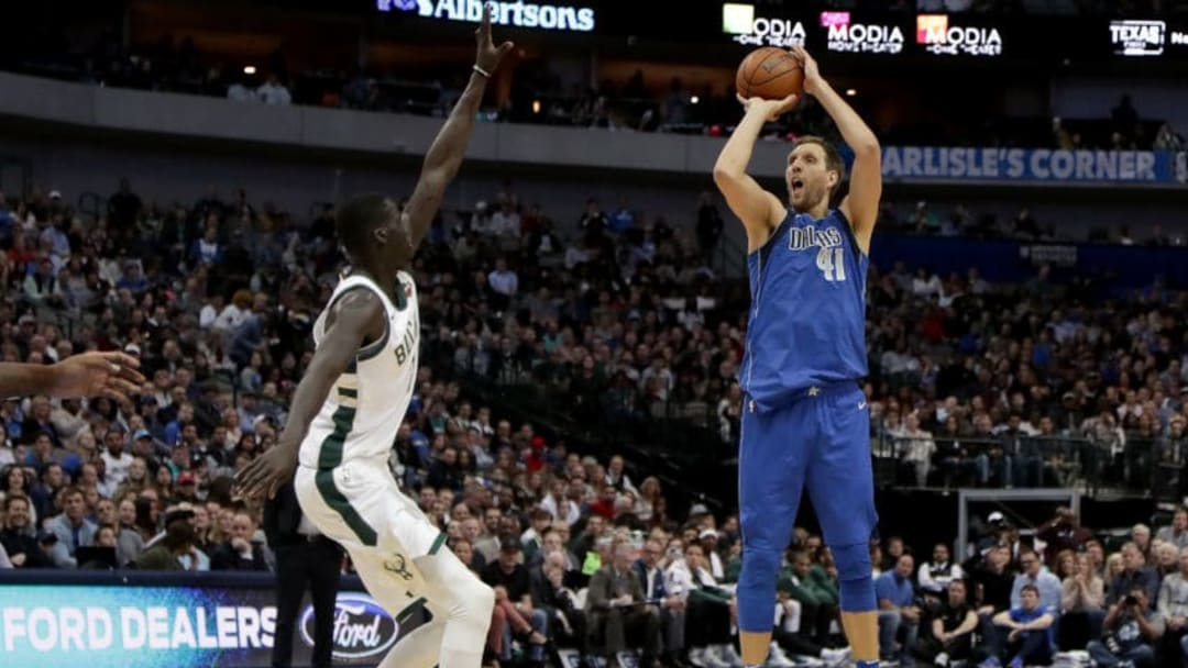 DALLAS, TX - NOVEMBER 18: Dirk Nowitzki #41 of the Dallas Mavericks shoots the ball against Thon Maker #7 of the Milwaukee Bucks in the first half at American Airlines Center on November 18, 2017 in Dallas, Texas. NOTE TO USER: User expressly acknowledges and agrees that, by downloading and or using this photograph, User is consenting to the terms and conditions of the Getty Images License Agreement. (Photo by Tom Pennington/Getty Images)
