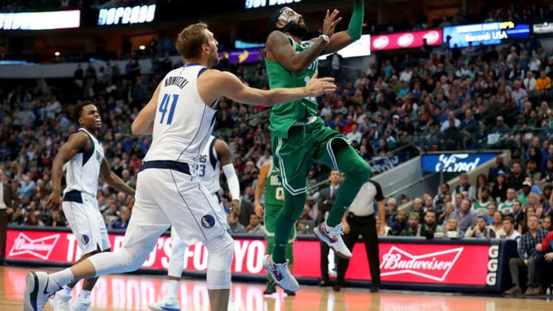 DALLAS, TX - NOVEMBER 20: Kyrie Irving #11 of the Boston Celtics drives to the basket against Dirk Nowitzki #41 of the Dallas Mavericks at American Airlines Center on November 20, 2017 in Dallas, Texas. NOTE TO USER: User expressly acknowledges and agrees that, by downloading and or using this photograph, User is consenting to the terms and conditions of the Getty Images License Agreement. (Photo by Tom Pennington/Getty Images)
