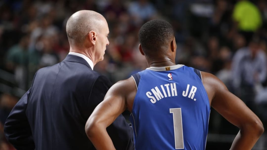 DALLAS, TX - DECEMBER 4: Rick Carlisle coaches Dennis Smith Jr. #1 of the Dallas Mavericks during the game against the Denver Nuggets on December 4, 2017 at the American Airlines Center in Dallas, Texas. NOTE TO USER: User expressly acknowledges and agrees that, by downloading and or using this photograph, User is consenting to the terms and conditions of the Getty Images License Agreement. Mandatory Copyright Notice: Copyright 2017 NBAE (Photo by Glenn James/NBAE via Getty Images)
