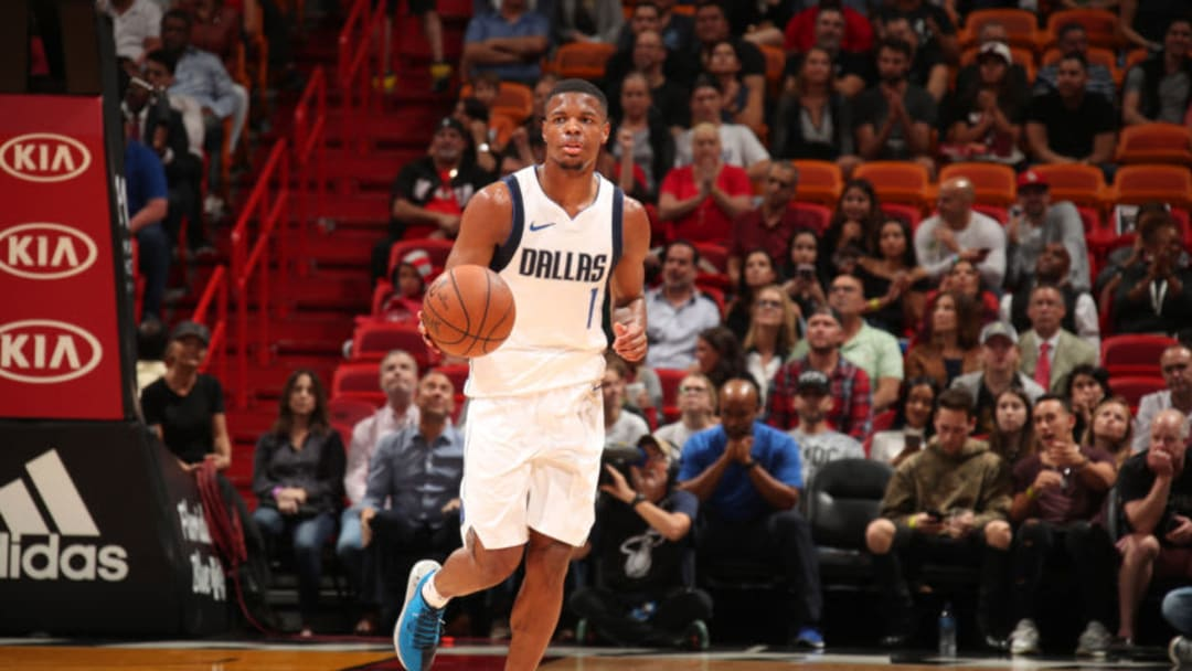 MIAMI, FL - DECEMBER 22: Dennis Smith Jr. #1 of the Dallas Mavericks handles the ball against the Miami Heat on December 22, 2017 at American Airlines Arena in Miami, Florida. NOTE TO USER: User expressly acknowledges and agrees that, by downloading and/or using this photograph, user is consenting to the terms and conditions of the Getty Images License Agreement. Mandatory Copyright Notice: Copyright 2017 NBAE (Photo by Issac Baldizon/NBAE via Getty Images)