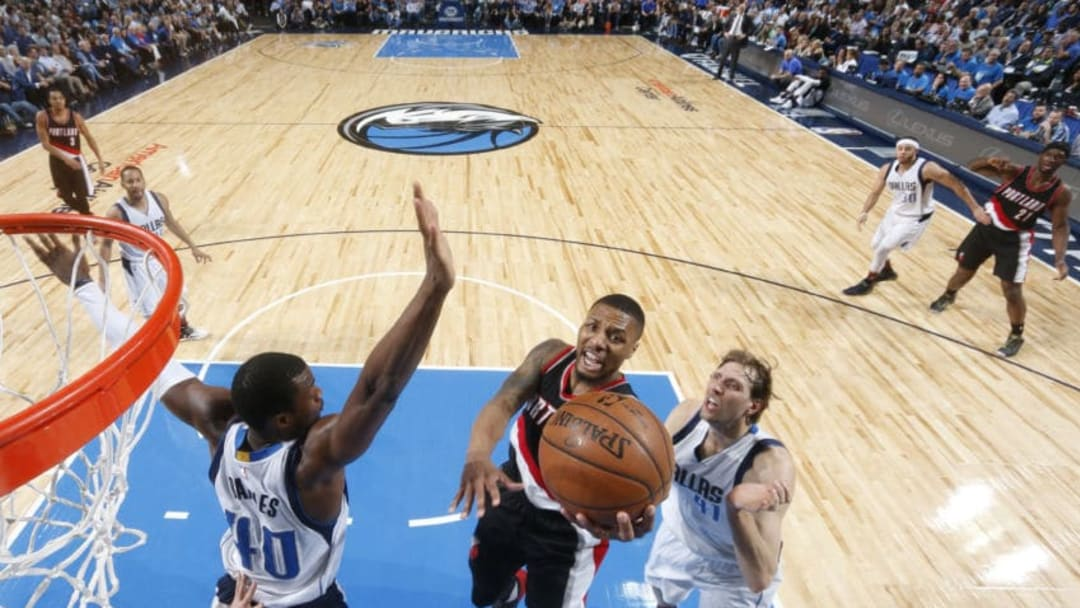 DALLAS, TX - FEBRUARY 7: Damian Lillard #0 of the Portland Trail Blazers goes in for the lay up against the Dallas Mavericks on February 7, 2017 at the American Airlines Center in Dallas, Texas. NOTE TO USER: User expressly acknowledges and agrees that, by downloading and or using this photograph, User is consenting to the terms and conditions of the Getty Images License Agreement. Mandatory Copyright Notice: Copyright 2017 NBAE (Photo by Glenn James/NBAE via Getty Images)