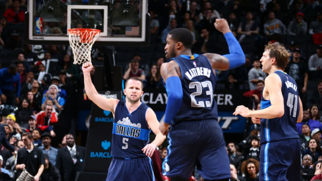 BROOKLYN, NY - DECEMBER 23: J.J. Barea #5 and Wesley Matthews #23 of the Dallas Mavericks celebrates after a play against the Brooklyn Nets during the game on December 23, 2015 at Barclays Center in Brooklyn, New York. NOTE TO USER: User expressly acknowledges and agrees that, by downloading and or using this Photograph, user is consenting to the terms and conditions of the Getty Images License Agreement. Mandatory Copyright Notice: Copyright 2015 NBAE (Photo by Nathaniel S. Butler/NBAE via Getty Images)