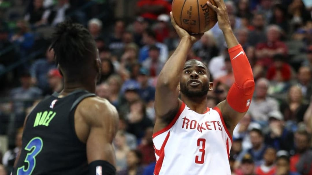 DALLAS, TX - MARCH 11: Chris Paul #3 of the Houston Rockets takes a shot against Nerlens Noel #3 of the Dallas Mavericks at American Airlines Center on March 11, 2018 in Dallas, Texas. NOTE TO USER: User expressly acknowledges and agrees that, by downloading and or using this photograph, User is consenting to the terms and conditions of the Getty Images License Agreement. (Photo by Ronald Martinez/Getty Images)