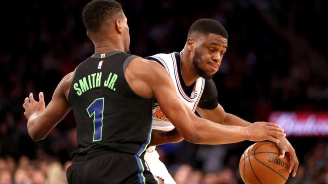 NEW YORK, NY - MARCH 13: Emmanuel Mudiay #1 of the New York Knicks works against Dennis Smith Jr. #1 of the Dallas Mavericks in the third quarter during their game at Madison Square Garden on March 13, 2018 in New York City. NOTE TO USER: User expressly acknowledges and agrees that, by downloading and or using this photograph, User is consenting to the terms and conditions of the Getty Images License Agreement. (Photo by Abbie Parr/Getty Images)