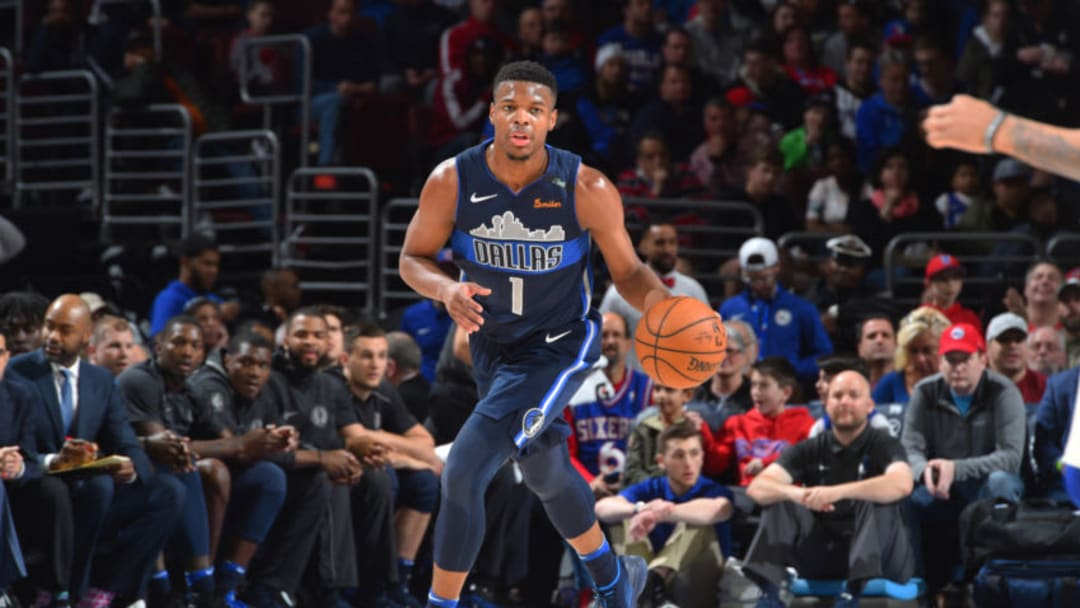 PHILADELPHIA, PA - APRIL 8: Dennis Smith Jr. #1 of the Dallas Mavericks handles the ball against the Philadelphia 76ers on April 8, 2018 at Wells Fargo Center in Philadelphia, Pennsylvania. NOTE TO USER: User expressly acknowledges and agrees that, by downloading and/or using this photograph, user is consenting to the terms and conditions of the Getty Images License Agreement. Mandatory Copyright Notice: Copyright 2018 NBAE (Photo by Jesse D. Garrabrant/NBAE via Getty Images)
