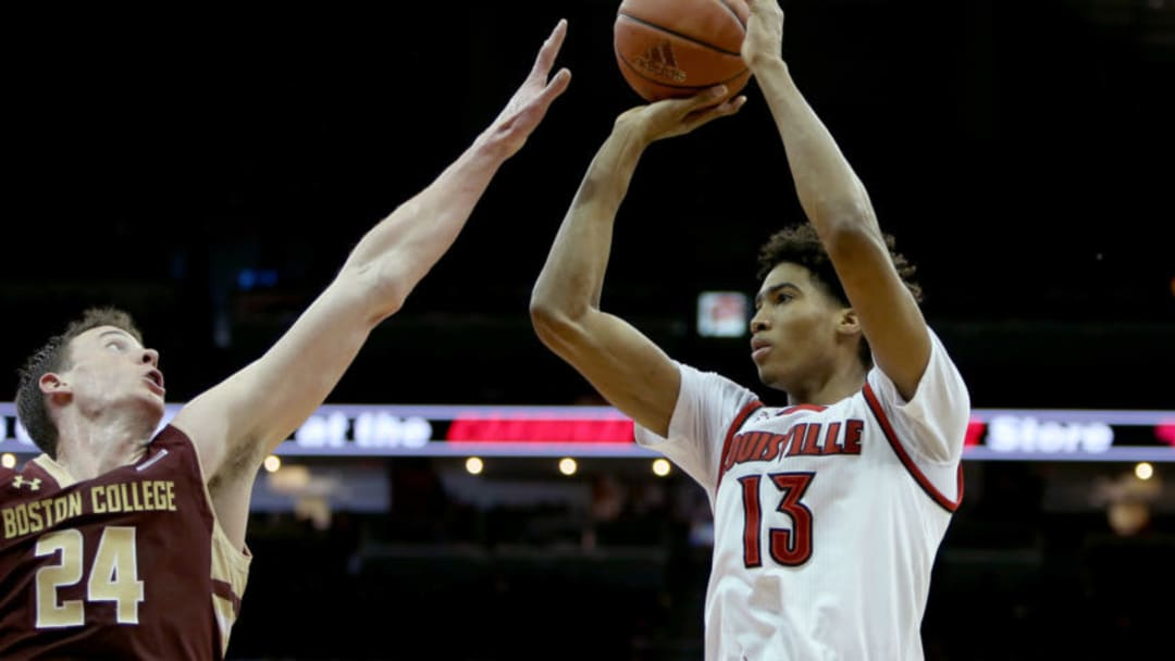 LOUISVILLE, KY - FEBRUARY 6: Raymond Spalding #13 of the Louisville Cardinals attempts a shot over Dennis Clifford #24 of the Boston College Eagles during the second half at KFC Yum! Center on February 6, 2016 in Louisville, Kentucky. (Photo by Dylan Buell/Getty Images)
